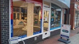 Smashed shop window in Heathfield