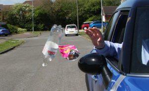 Litter being thrown from a car