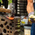 blacksmith at forge