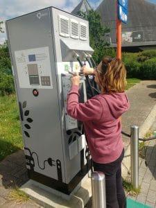 Sarah at a charging statiom