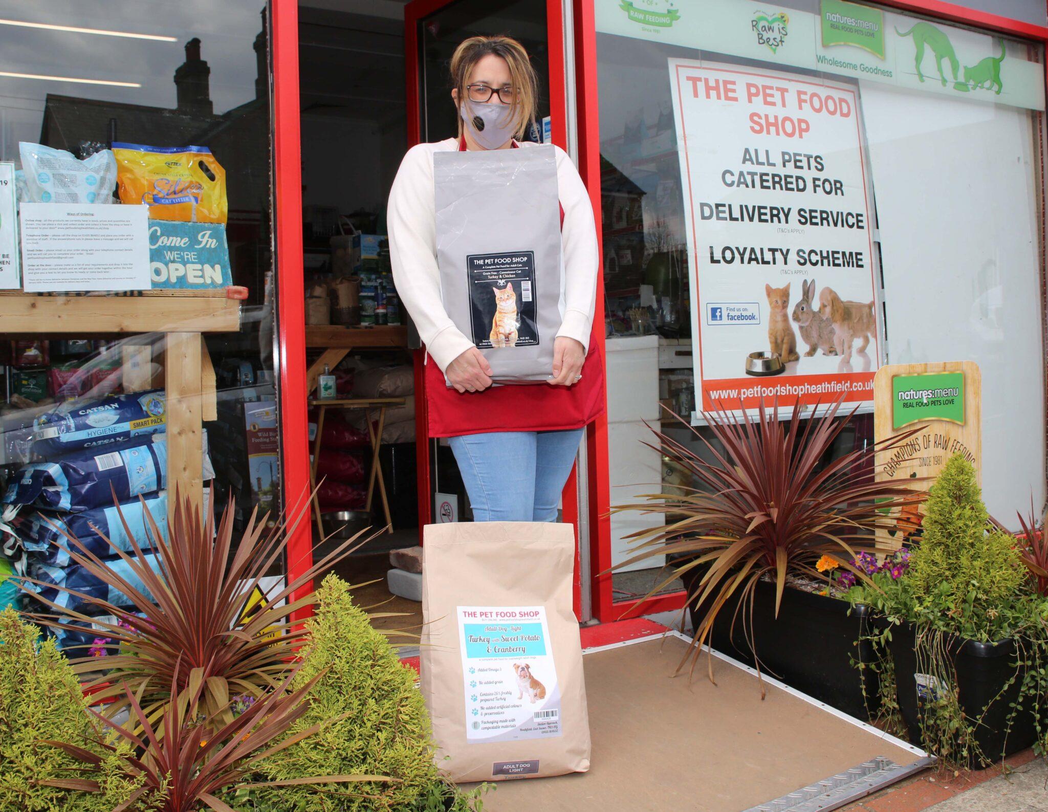 Shop assistant with pet food